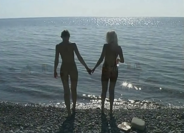 Two young nudists on the Beach