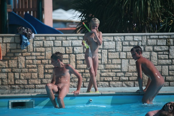 Young Family Nudist Pool Party